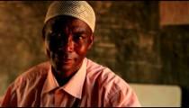 Close up of a Muslim man in a village in Kenya.