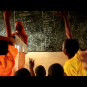 Teacher in a full classroom in Kenya.