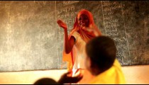 Teacher in a full classroom in a school in Kenya.
