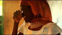 Close up of a teacher in a full classroom in Kenya.