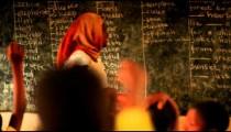 Schoolteacher in a full classroom in Kenya.