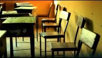 Empty desks in a classroom in a Kenyan village.