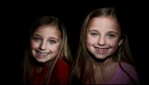 Royalty Free Stock Footage of Young twin girls smiling.