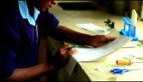 Close up of a girl doing chemistry in Kenya.