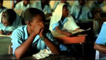 Students taking a test in a class in a school in Kenya.