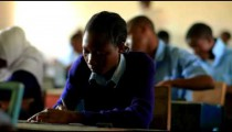 Students taking a test in a class in Kenya.