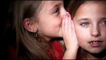 Royalty Free Stock Footage of Young twin girls whispering.