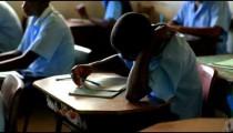 Students taking a test in a schoolroom in Kenya.