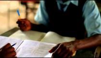 Students taking a test in a class in a Kenyan school.