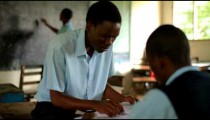 Students taking a test in a Kenyan school.
