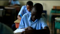 Students taking a test in an African school.