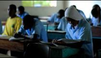 Students test taking in a class in a school in Kenya.