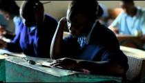 Students taking an exam in class in a school in Kenya.