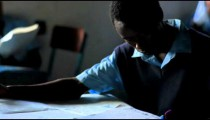 Students taking an exam in a classroom in Kenya