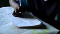 Students taking an exam in school in a village in Kenya.