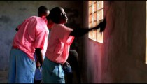Painting the inside of a school in a village in Kenya.