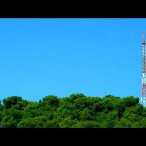 Royalty Free Stock Video Footage of radio tower in a forest shot in Israel at 4k with Red.
