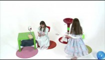 Royalty Free Stock Footage of One girl spinning and her twin playing with makeup.