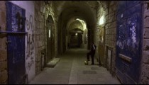 Stock Video Footage of a boy controlling a soccer ball in an alley filmed in Israel at 4k with Red.