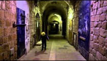 Stock Video Footage of a boy juggling a soccer ball in an alley filmed in Israel at 4k with Red.