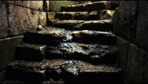 Stock Video Footage of water running down old stone stairs shot in Israel at 4k with Red.