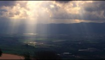 Royalty Free Stock Video Footage of sun rays illuminating a valley shot in Israel at 4k with Red.