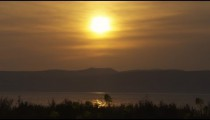 Stock Video Footage of a yellow sunset at the Sea of Galilee shot in Israel at 4k with Red.