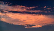 Royalty Free Stock Video Footage of white and orange clouds at sunset shot in Israel at 4k with Red.