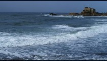 Royalty Free Stock Video Footage panorama of Caesarea and waves shot in Israel at 4k with Red.