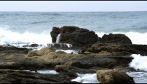 Royalty Free Stock Video Footage of waves and rocky shore shot in Israel at 4k with Red.