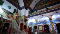 Stock Footage of a man in the Jezzar Pasha Mosque in Israel.