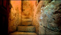 Stock Footage of a narrow stone spiral staircase in Israel.