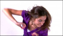 Clip of a dancing girl in a purple shirt.