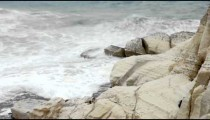 Stock Footage of waves crashing against a rocky, white shore in Israel.