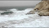 Stock Footage of waves splashing against a rocky shore in Israel.