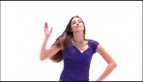 Clip of a dancing girl in a purple shirt on a white background.