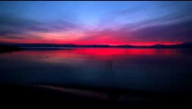 Stock Footage of the sky at sunset reflecting in the Sea of Galilee in Israel.