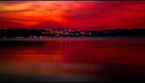 Stock Footage of distant city lights at night from across the Sea of Galilee in Israel.