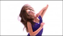 Clip of a girl dancing in a purple shirt on a white background.