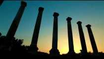 Stock Footage of ancient silhouetted columns at sunset in Israel.