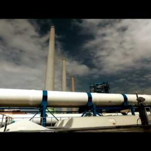 Stock Footage of a white pipeline and smokestacks in Israel.