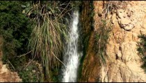 Stock Footage of a small Ein Gedi waterfall in Israel.