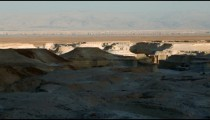 Stock Footage of a desert landscape half in shadows in Israel.