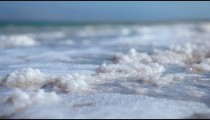 Stock Footage of salt deposits on the shore of the Dead Sea in Israel.