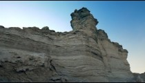 Stock Footage of a gray layered rock formation in the desert in Israel.
