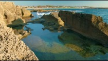a rocky tidal pool at the Mediterranean in Israel.