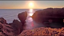 the rocky Dor Beach coast at sunset in Israel.