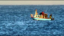 A surfer and fishing boat on the Mediterranean shot in Israel.
