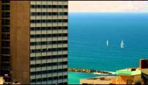 Panning shot of Mediterranean sailboats and Tel Aviv shot in Israel.