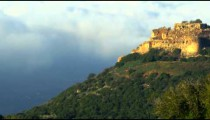 Panning shot of Nimrod Fortress above clouds shot in Israel.